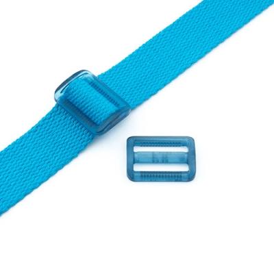 Gurtband-Regulierer 25mm blau transparent
