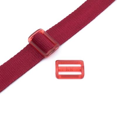 Gurtband-Regulierer 25mm rot transparent